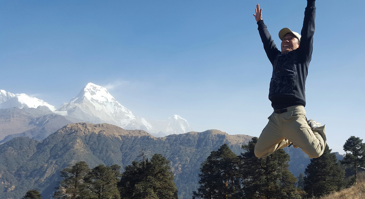 Jumping joy with nature and mountains Poonhill trek