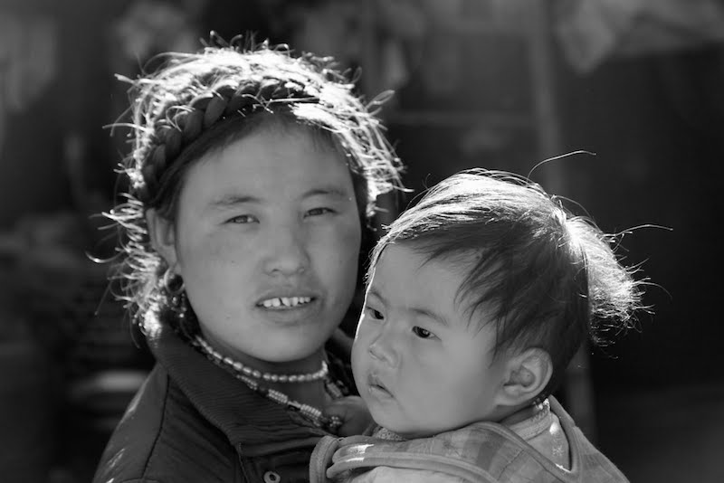 Local mother and kid in Tsum valley area - Manaslu Tusm valley trekking