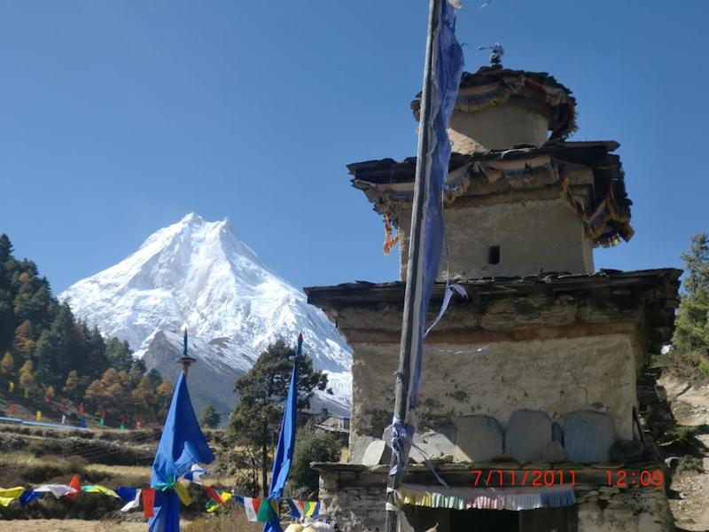 Stupa and Mt. Manaslu on back ground Manaslu circuit trekking