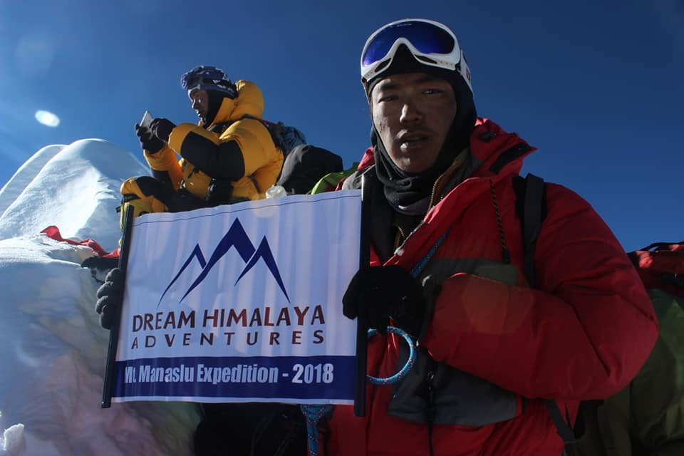 Tendi on Mt. Manaslu Summit with Dream Himalaya Adventures banner